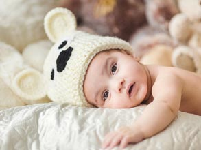 Newborn with a cute teddy bear hat