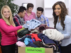 College aged students sorting clothing donations