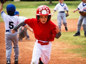Little league baseball player running the bases